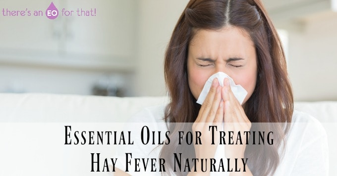 Essential Oils for Treating Hay Fever Naturally - girl sneezing into a tissue