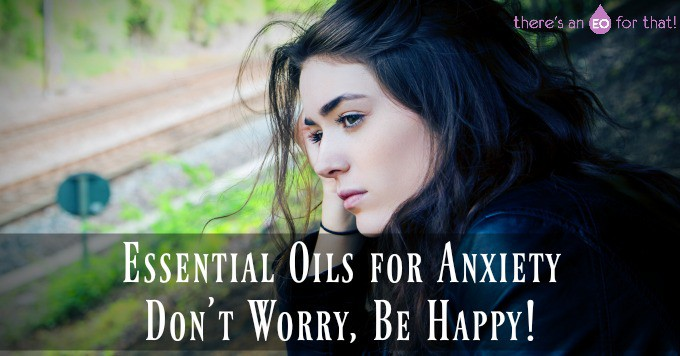 Troubled girl staring off into the distance -Essential Oils for Anxiety